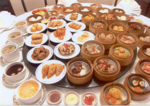 a large selection of dishes served on a round table