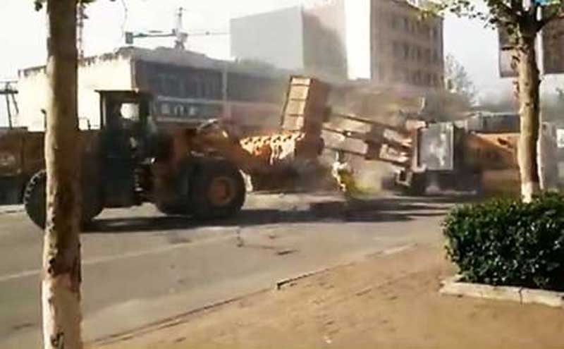 side view of a bulldozer battle on the streets of northern china