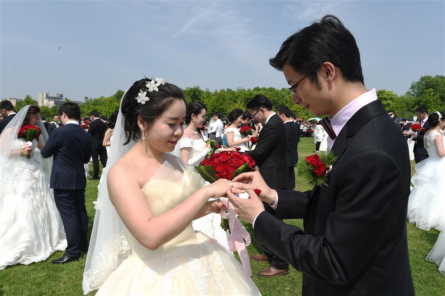 close up photo of a couple getting married in front of more couples also getting married