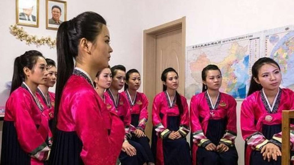 a group of north korea waitresses in a restaurant in china