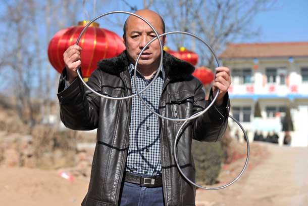 a man performing magic tricks in liyu village in china
