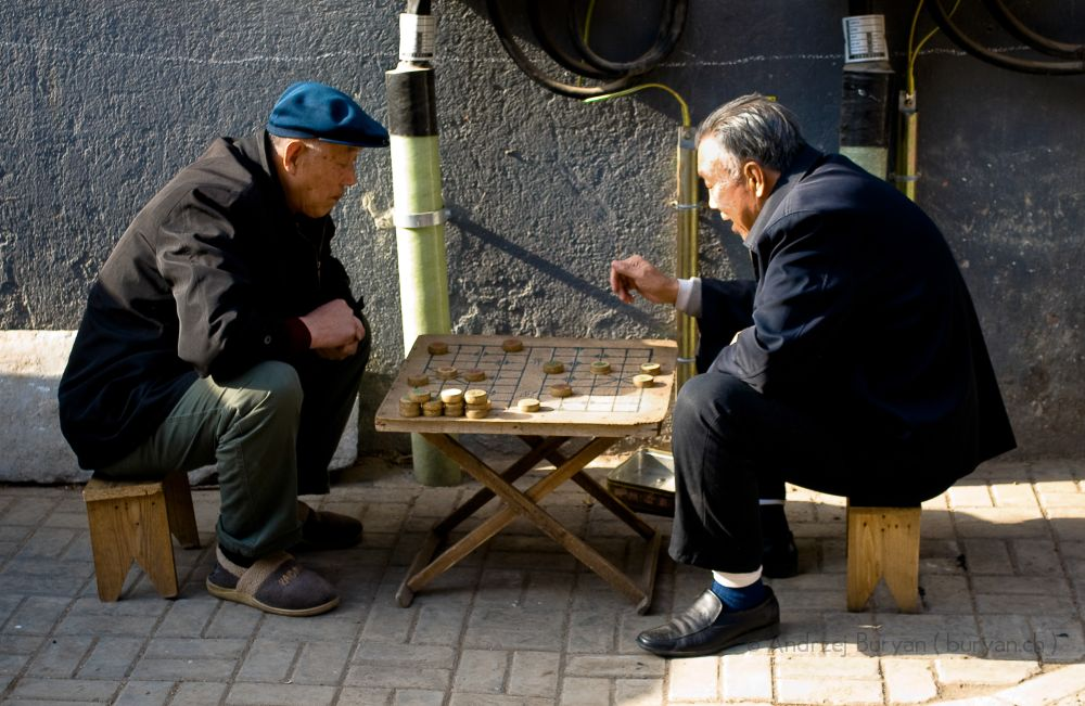 two chinese men playing go