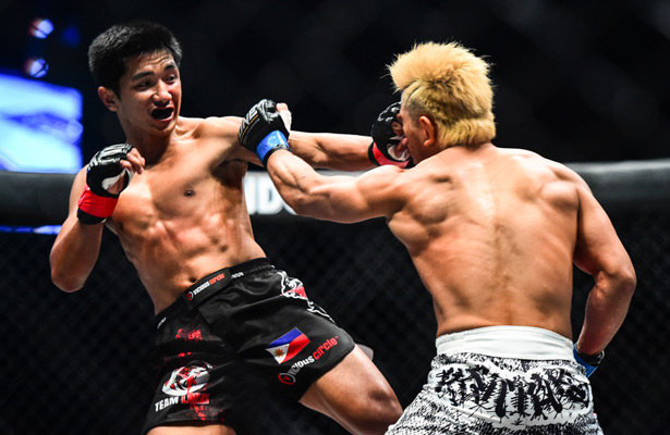 two fighters competing in an mma fight