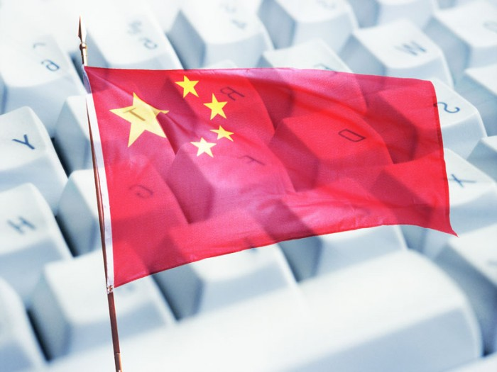 chinese flag in front of a keyboard