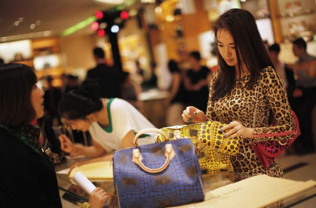 China's rising middle class woman purchasing a hangbag