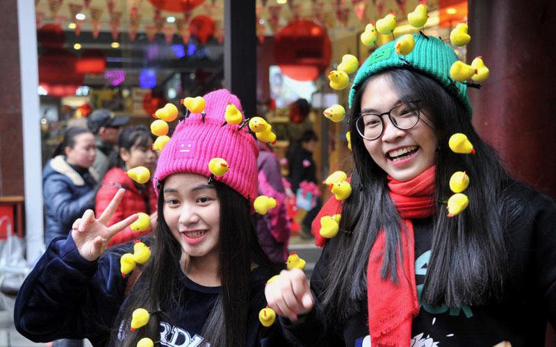 two girls with chick headwear in china