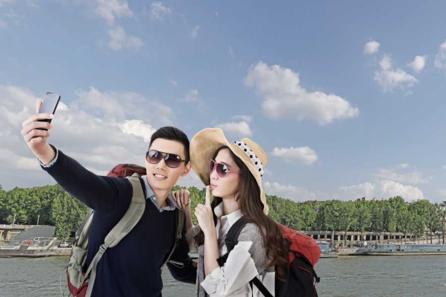 Two Chinese tourists pose for a selfie