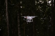 drone flying in a forrest