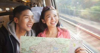 couple with a map on a train