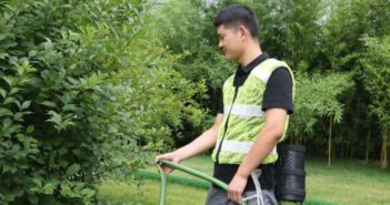side view of man working outside wearing wearable aircon vest