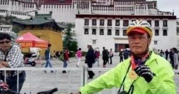 elderly cyclist in lhasa
