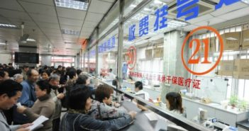 people queueing to pay at hospital in china