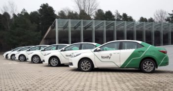 side view of a line of taxify cars