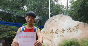 boy holding his uni admission certificate in china
