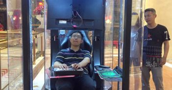 man in relaxation booth at shopping mall in shanghai