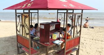 people reading at beach book bar in china