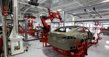 back view of car being manufactured in tesla factory