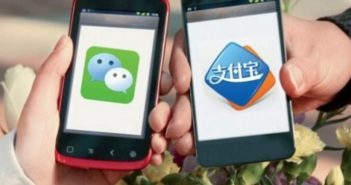 two phones with wechat and alipay logos displayed