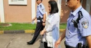 police escorting a woman in china