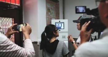 back view of girl using facial recognition with cameras recording