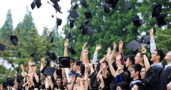 uni graduates throwing hats in the air in china