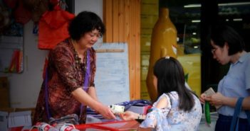woman serving children popsicles in china