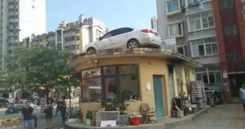 car on a building roof in china