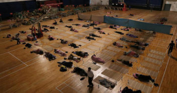 parents sleeping in a university gym in china