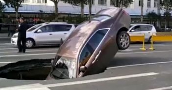 front end of rolls royce in a sink hole in china