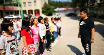 sports teacher with children in china