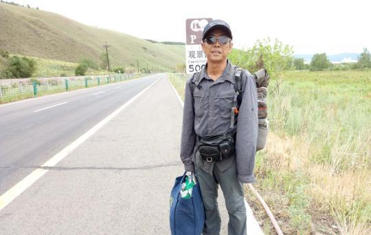 man standing next to road in inner mongolia