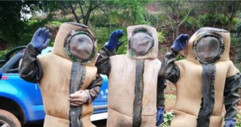three men wearing beekeeper outfits in china
