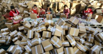 workers sorting packages at warehouse in china