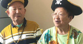 elderly couple in china wearing pirate hats