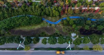 arial view of a blue road running next to a main road in china