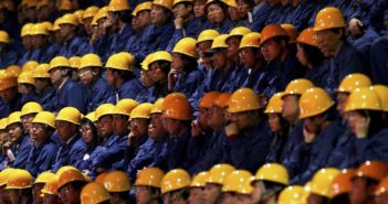 construction workers in china sitting in rows