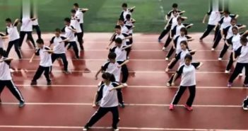 students performing opera on sports track at school in china