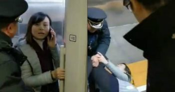 woman blocking train door in china