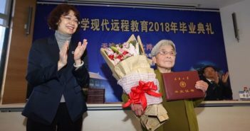 elderly woman receiving degree in china