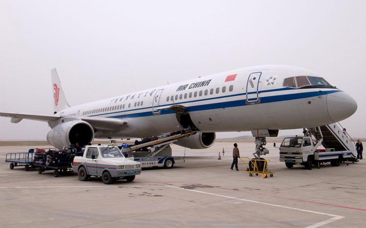 front and side view of air china plane being prepped for take-off