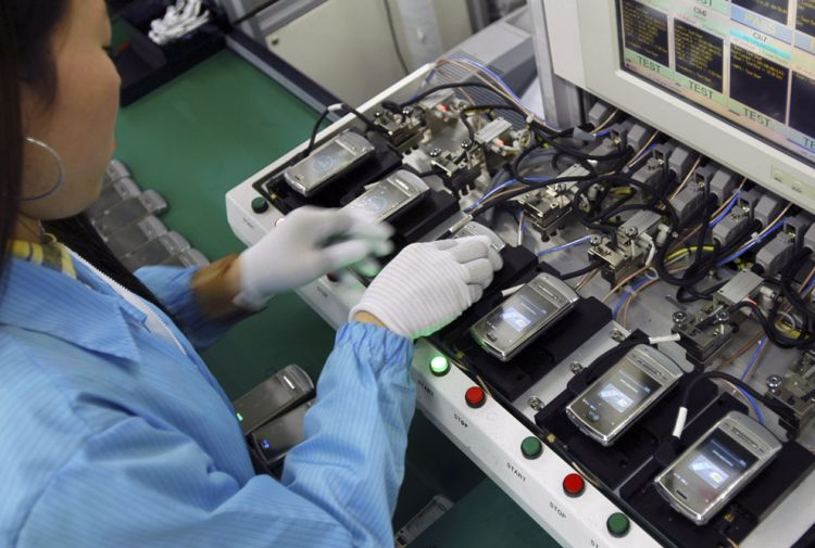 worker assembling mobile phones at factory in china