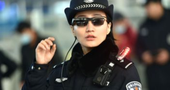 chinese police officer wearing facial recognition sunglasses