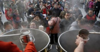 line of people queuing from porridge in china