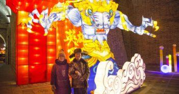 couple standing in front of coloured lantern in china