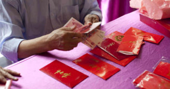 hongbao on table with someone counting money