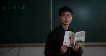 teacher standing in front of blackboard in china
