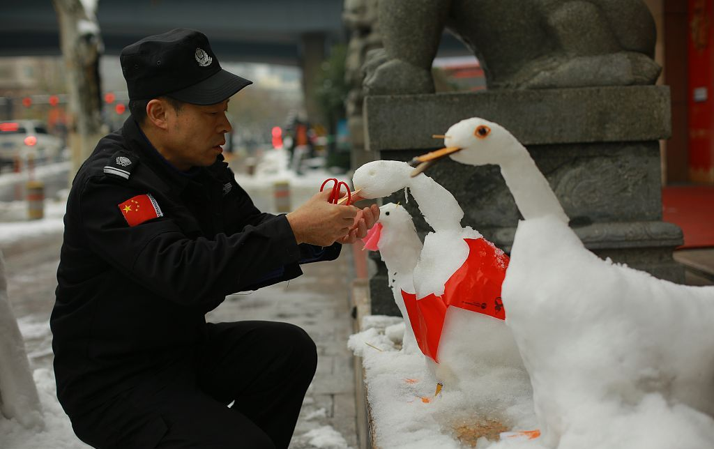 security guard making snow animals in china