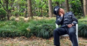 security guard sleeping outside on a chair in china