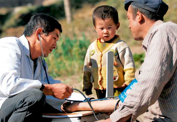 village doctor taking blood pressure in china