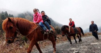 children riding horses in china